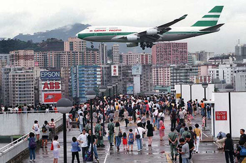 HONG KONG, CHINA:  Hundreds of Hong Kong people gather onto Kai Tak Airport's rooftop car-park 27 June to capture a momento of planes making their approach toward the runway.  Remembered by millions of passengers and thousands of pilots for the spectacula