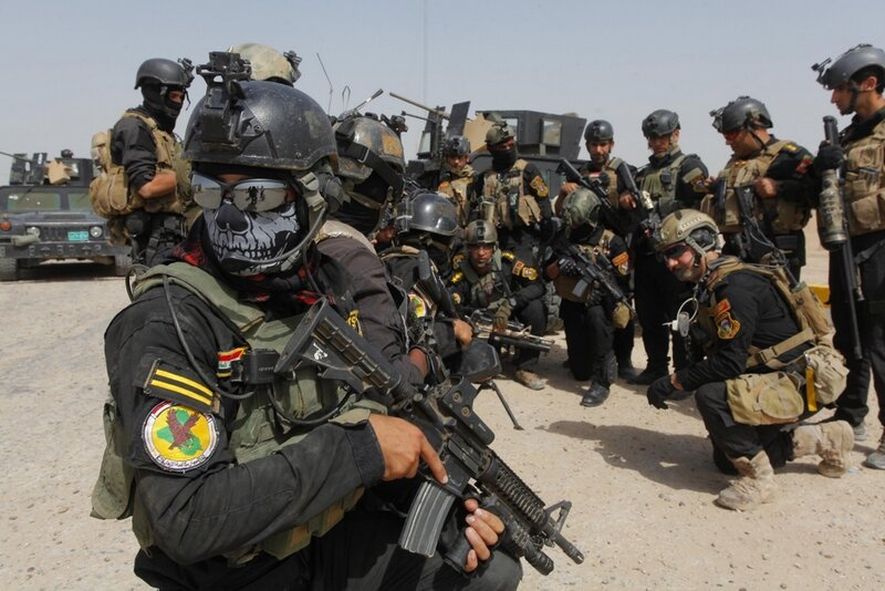 Members of the Iraqi Special Operations Forces prepare before going out on a patrol in the town of Jurf al-Sakharr