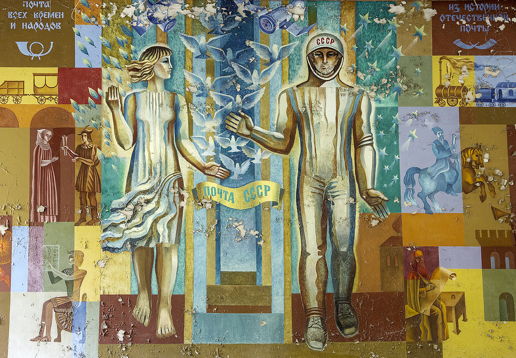 Soviet era mural representing Peace, Science, and Exploration - The mural is on a wall in the Pripyat Post Office which has been abandoned since the Chernobyl disaster in April 1986.jpg