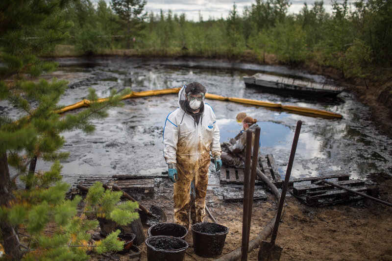 Greenpeace volunteers Anna Kopytova (Russia) and Emma Eineskog (Sweden) and Alban Grosdidier (Denmark) in oil spill clean up operation in a forest outside Usinsk in the Komi Republic. An international group of Greenpeace experts and volunteers together wi