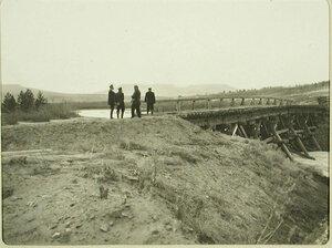 Группа чиновников у старого деревянного моста. Забайкальская обл. Китайский разъезд  ст.