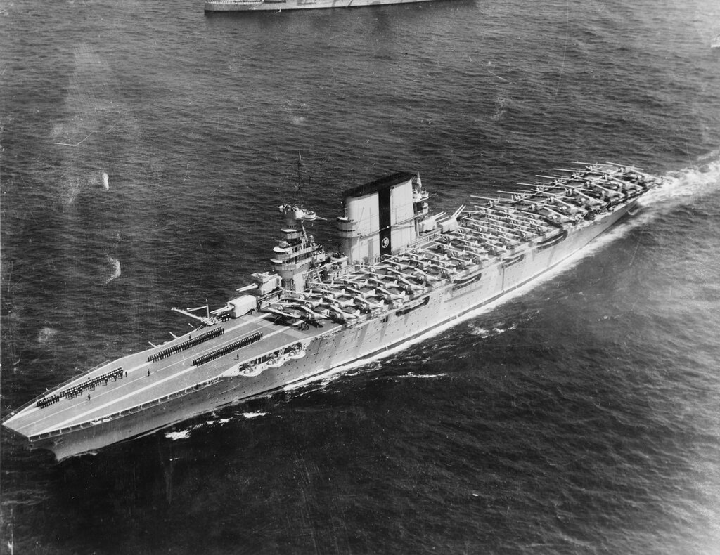 USS SARATOGA (CV-3) With some of her planes and crew on deck passes in review during the fleet review in New York, 31 May 1934