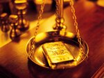 The_financial_crisis_Wallpaper_Gold_Gold_bullion_on_the_scales_013950_.jpg