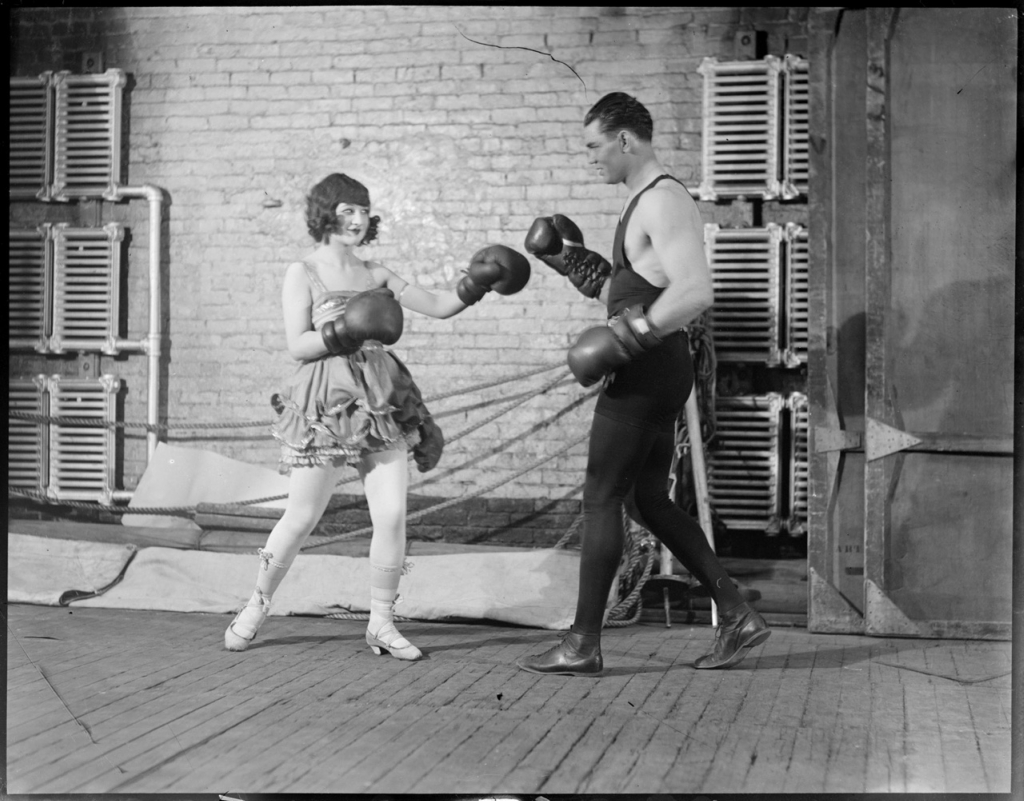 Jack Dempsey spars with actress.jpg