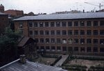 08. Вид огороженных садов возле неопознанного здания