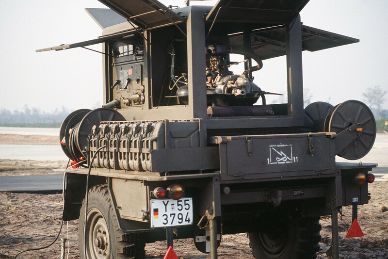 A West German gas-powered generator in operation during an autobahn landing exercise.