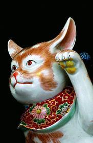 Манеки Нэко. Кошка, приглашающая счастье