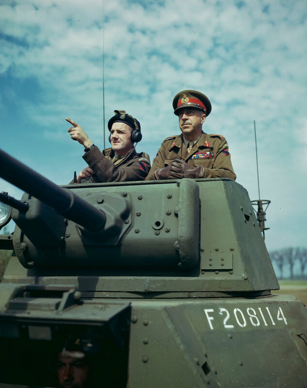 Canadian Lieutenant-General Henry Krerar and Lieutenant Clifford Smith on the Tower of a Daimler armoured car