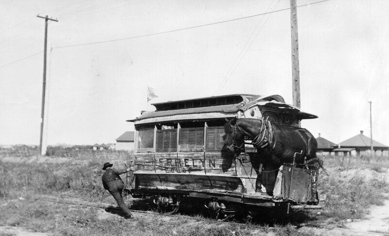 Conductor pulls the Cherrelyn Gravity and Broncho Street Railway horse car to the top of the hill for the return trip down to Orchard Place, from Cherrelyn, Arapahoe County, Colorado. Between 1905 and 1910