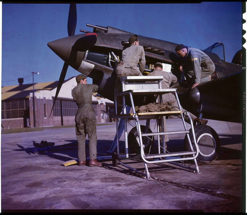 US Army Air Force Curtiss P-40B Warhawk being worked on, on the east coast of the USA, ca. 1942
