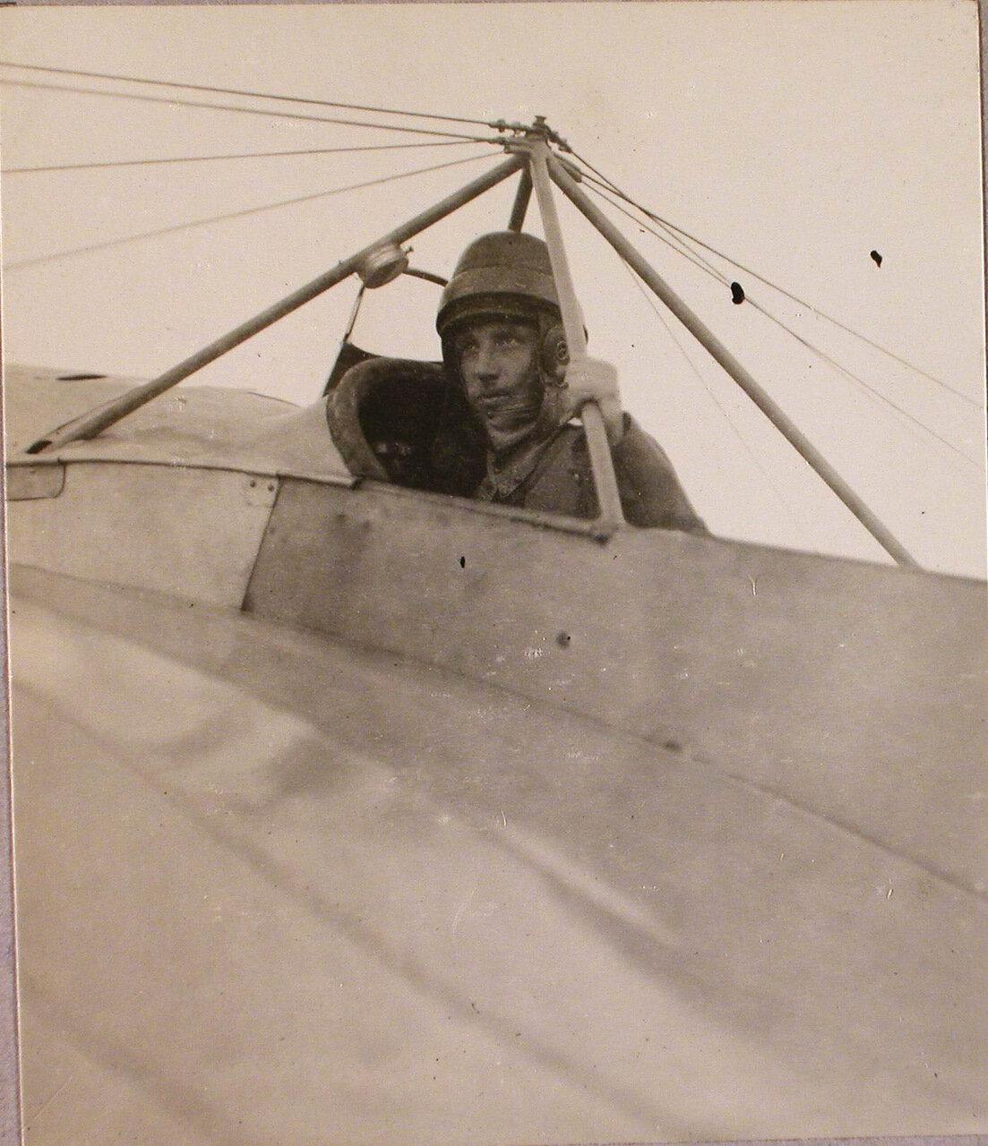 37. Военный летчик поручик Бржезовский в кабине летательного аппарата. Июль-август 1915. Ковель
