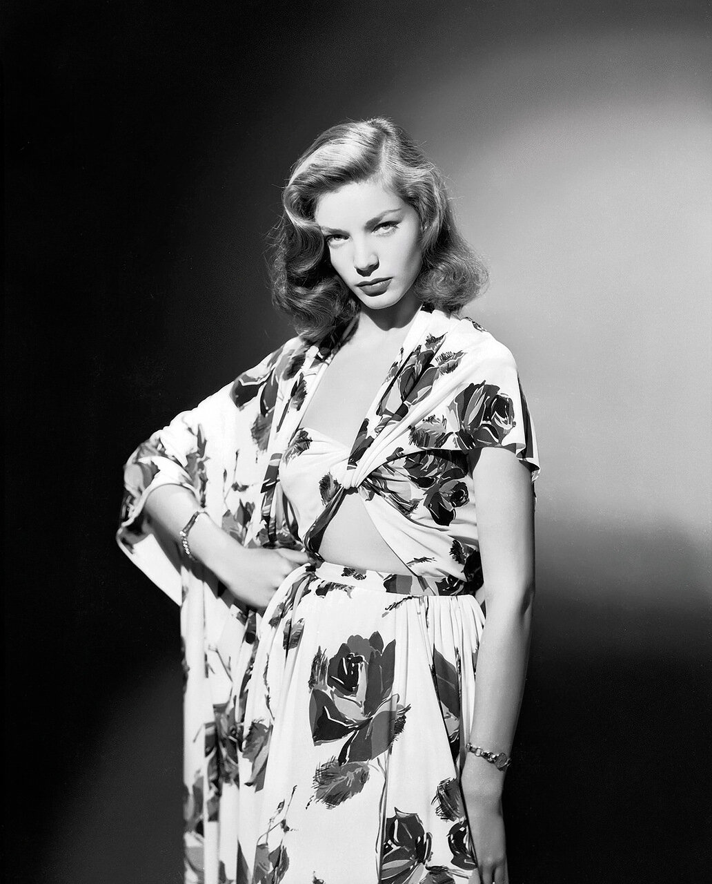 circa 1945: American screen star Lauren Bacall wearing a summer suit in a bold floral print.