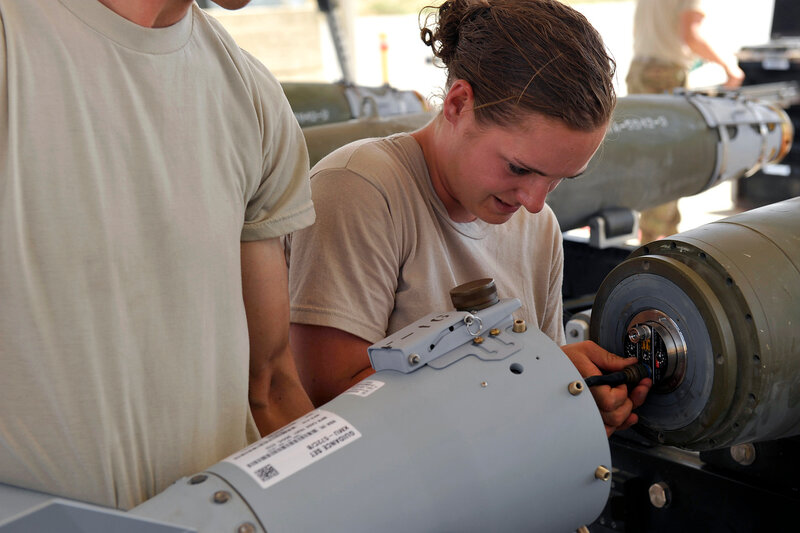 BAGRAM AIRFIELD, Afghanistan -- U.S. Air Force Airman 1st Class Casey Cain, a munitions systems technician currently assigned to the 455th Expeditionary Maintenance Squadron connects an FMU-152 tail fuse during a GBU-38 bomb build. GBU-38s are key weapons