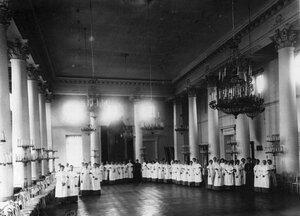 Воспитанницы в актовом зале.