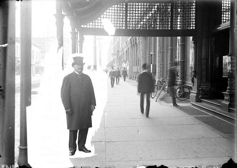 Portrait of a Daniels and Fisher doorman in Denver, Colorado. Circa 1902.