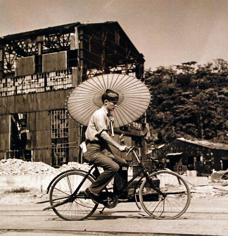 Seaman Paul Gray rides a Japanese bicycle in Tokyo, Japan. September 1945