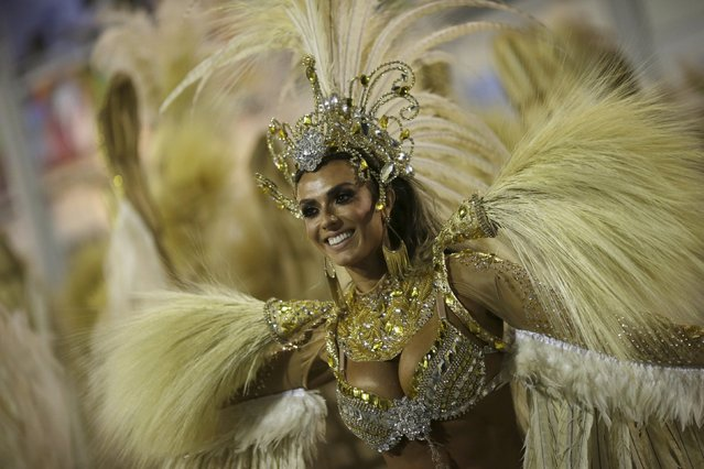 A reveller of the Vila Isabel samba school performs during the carnival parade at the Sambadrome in