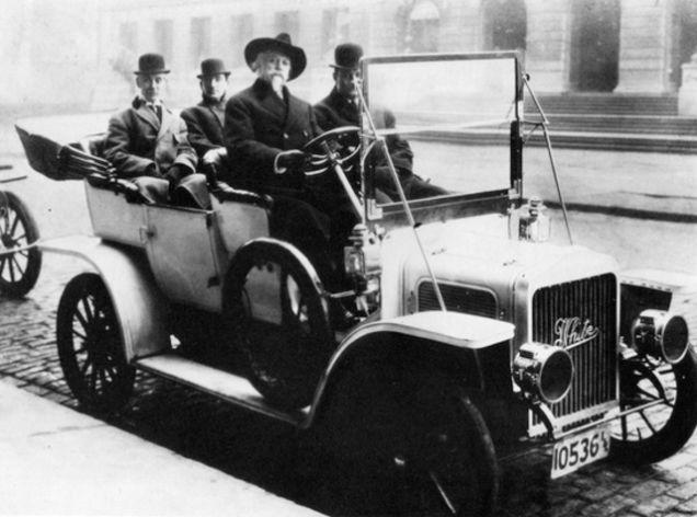 Buffalo Bill sitting in his steam-powered car in 1908.jpg
