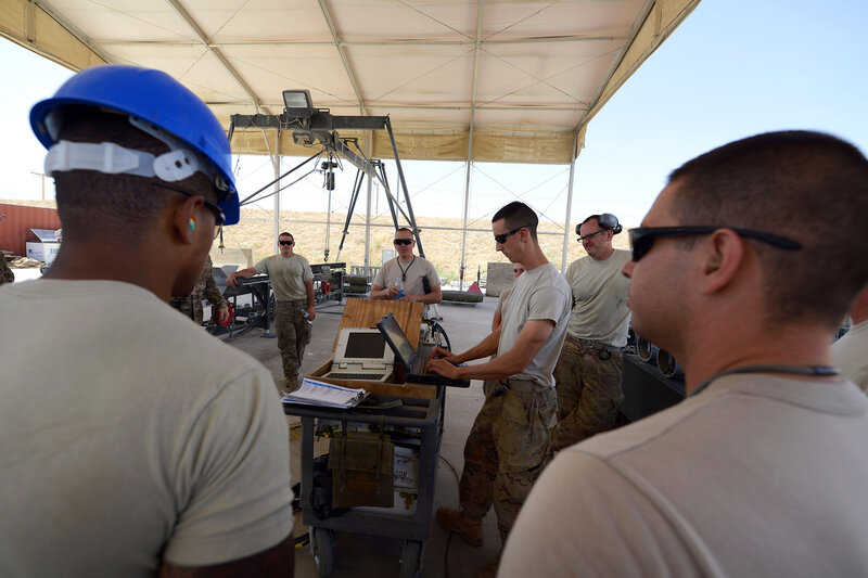 U.S. Air Force Airmen assigned to the 455th Expeditionary Maintenance Squadron gather together to review safety procedures before building 10 GBU-38 bombs at Bagram Airfield, Afghanistan Aug. 26, 2014. The GBU-38 is an essential part of the weapons system