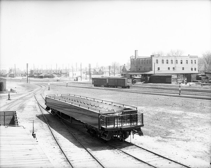 """Denver and Rio Grande excursion car number 780 parks in the Denver station yard, Denver, Colorado, 1905. The """"Scenic Line of the World"""" built three open observation cars with flip-back benches in 1905."""