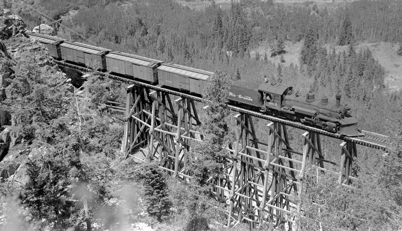 Denver & Rio Grande Western train (Narrow Gauge), engine number 464, engine type 2-8-2, on the Rio Grande Southern, crossing an Ophir trestle, June 27, 1945.