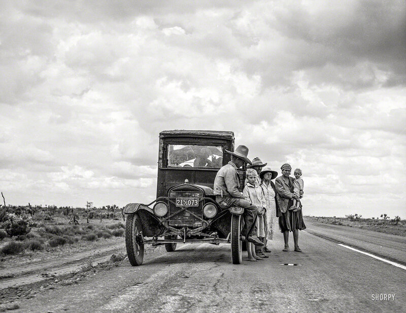 May 1937. One of three related Oklahoma drought refugee families on the highway near Lordsburg, New Mexico, going to Roswell to chop cotton