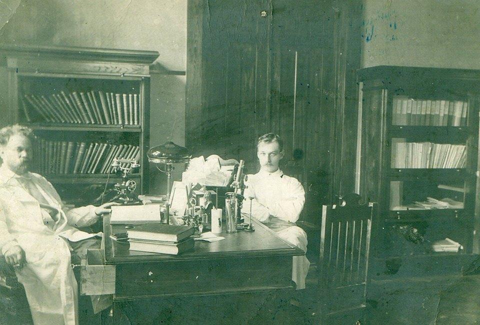 Dr. Shakov behind desk.jpg