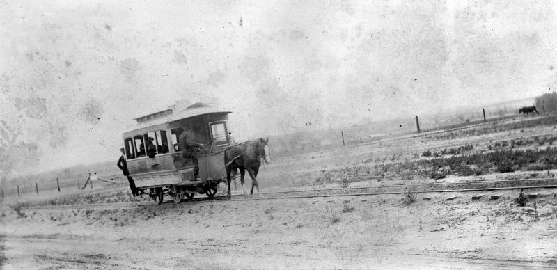 The conductor steers as the horse pulls the West Denver, Union 55 Depot trolley, with passengers on board, Denver, Colorado. Between 1900 and 1910