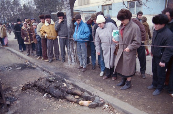 Romanians Looking at Burnt Corpse