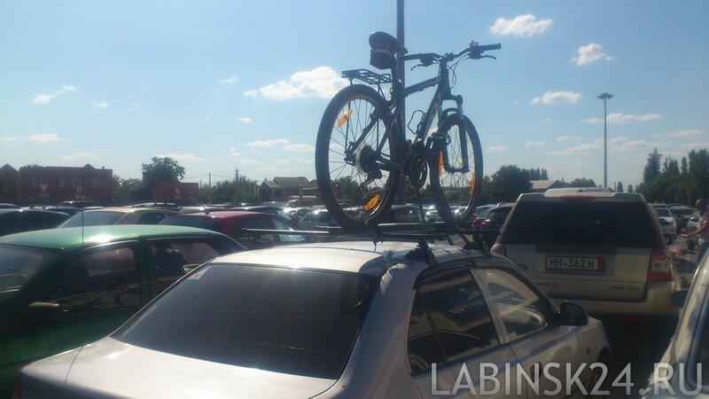 Как перевозить велосипед на крыше