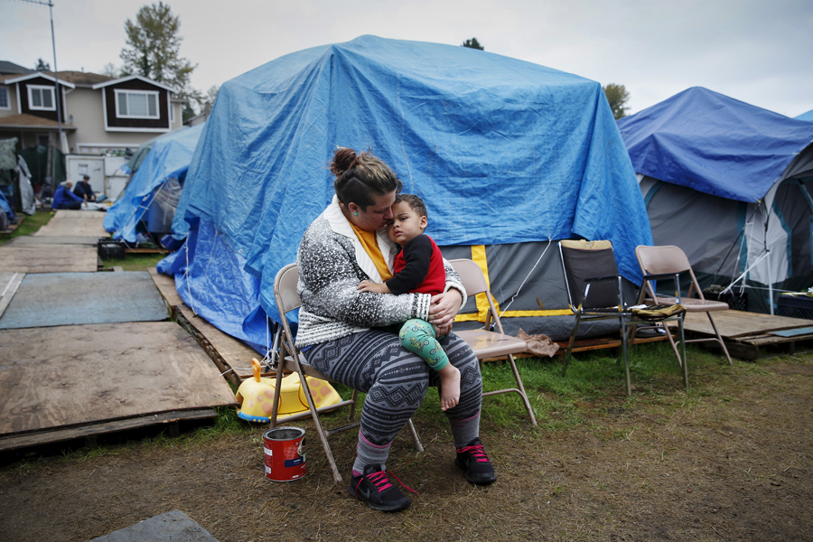 Kadee Ingram, 28, holds her son Sean, 2, at SHARE/WHEEL Tent City 3 outside Seattle on October 13, 2