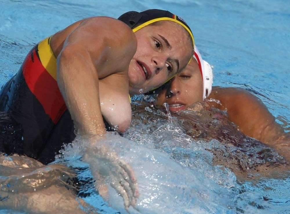 Claudia Blomenkamp of Germany fights for the ball with Lorana Miranda of Spain during their European Water Polo Championships preliminary match in Zagreb