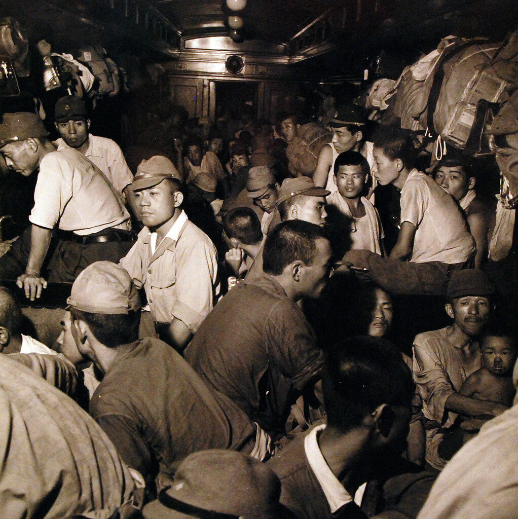 Discharged Japanese soldiers crowd trains as they take advantage of free transportation to their homes after end of World War II in Hiroshima. September 1945