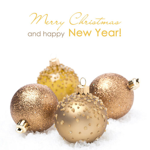 Different golden Christmas balls in the snow, isolated