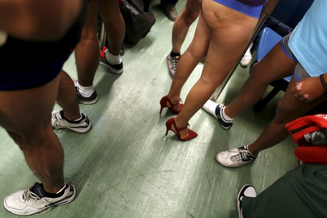 "Passengers not wearing pants stand in a subway train during the ""No Pants Subway Ride"" in Mexico Cit"