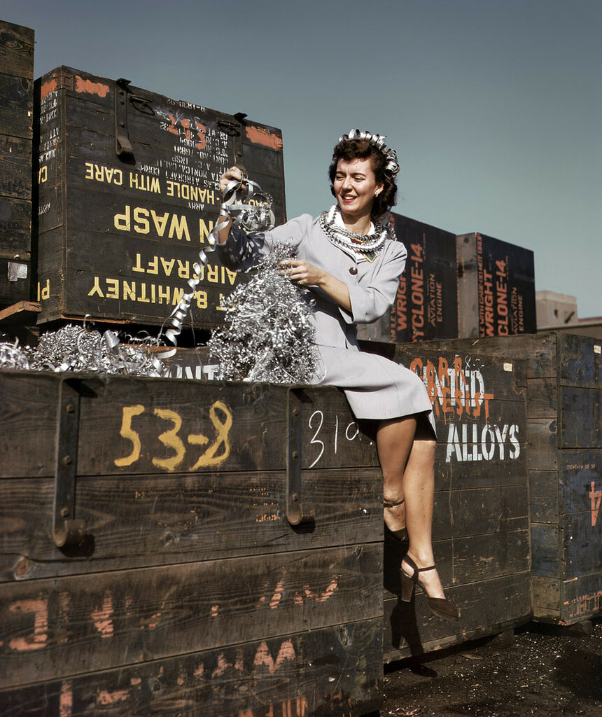 "Long Beach, California. October 1942. ""Annette del Sur publicizing salvage campaign in yard of Douglas Aircraft Company."".jpg"