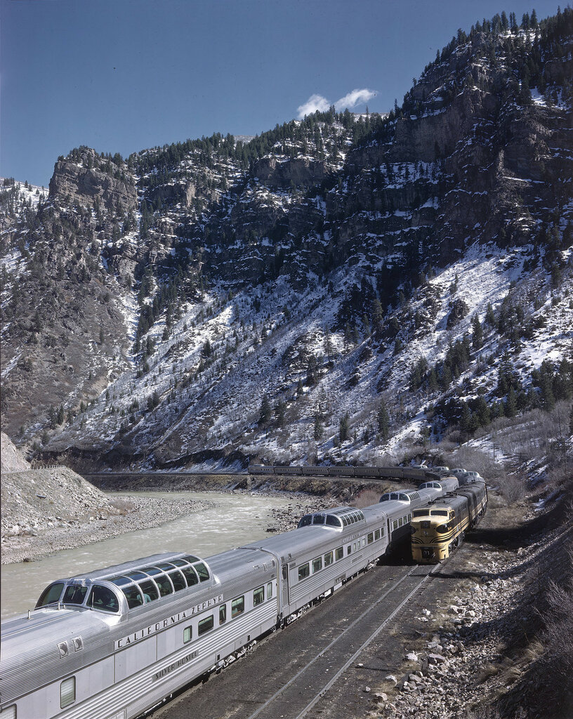 First CZ meet, Grizzly. Two California Zephyr express trains meet at a railroad siding (Grizzly) in Garfield County, Colorado, beside the Colorado River. 1949 Mar. 21