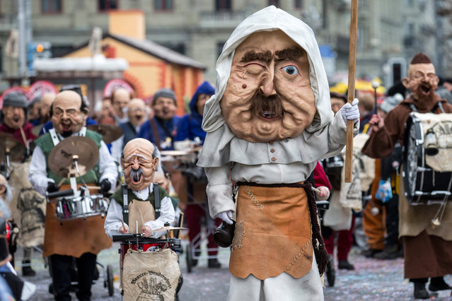 Disguised members of a carnival band participate in the carnival procession (Fasnacht) in the histor