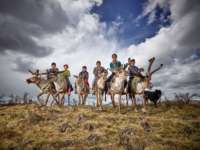 Peter Voss, Germany. Open Competition; Smile. Young reindeer farmers in Mongolia. (Photo by Peter Vo