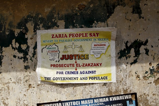 A political poster is seen on the wall of a house in Gyallesu district in Zaria, Kaduna state, Niger