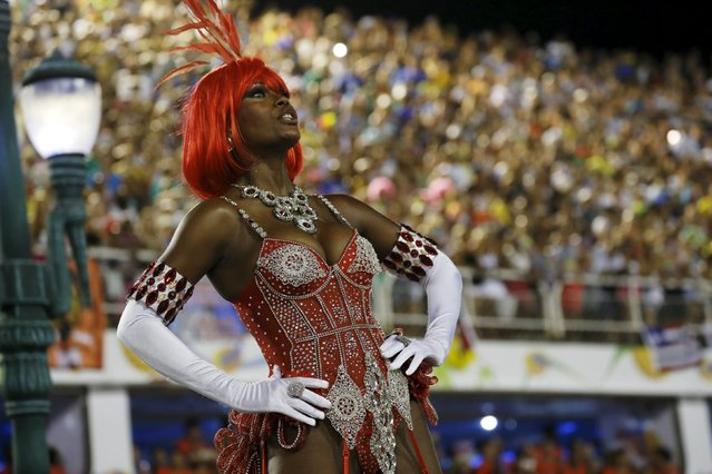 A reveller of Salgueiro samba school performs during the carnival parade at the Sambadrome in Rio de
