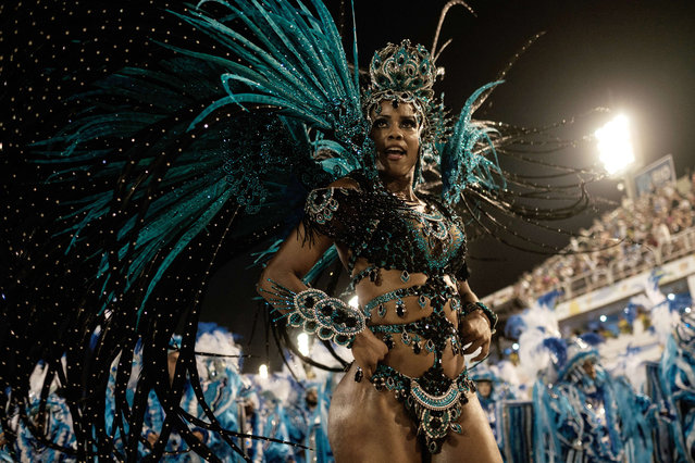 Revellers of Unidos da Tijuca samba school perform during the first night of the carnival parade at
