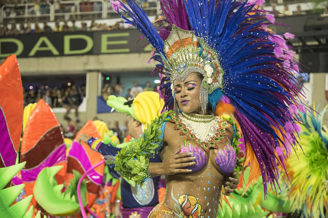 A performer dances during Uniao da Ilha performance at the Rio Carnival in Sambodromo on February 7,