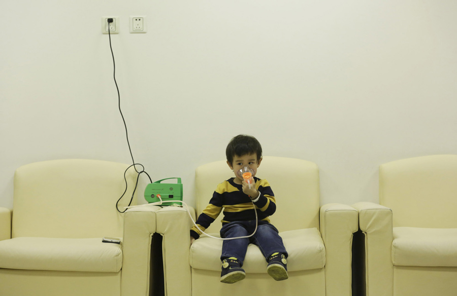 Three-year-old Hanhan receives nebulizer therapy on the third day after China's capital Beijing