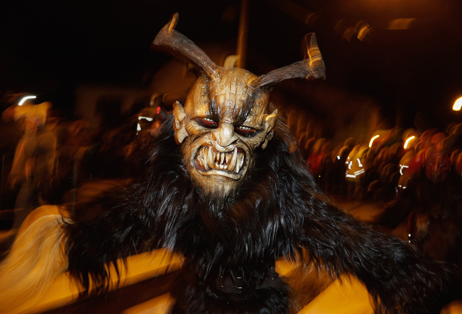 Participants dressed as Krampus walk the streets in search of delinquent children during a Krampus r