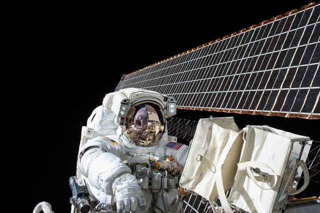 NASA astronaut Scott Kelly is seen while working outside of the International Space Station during a