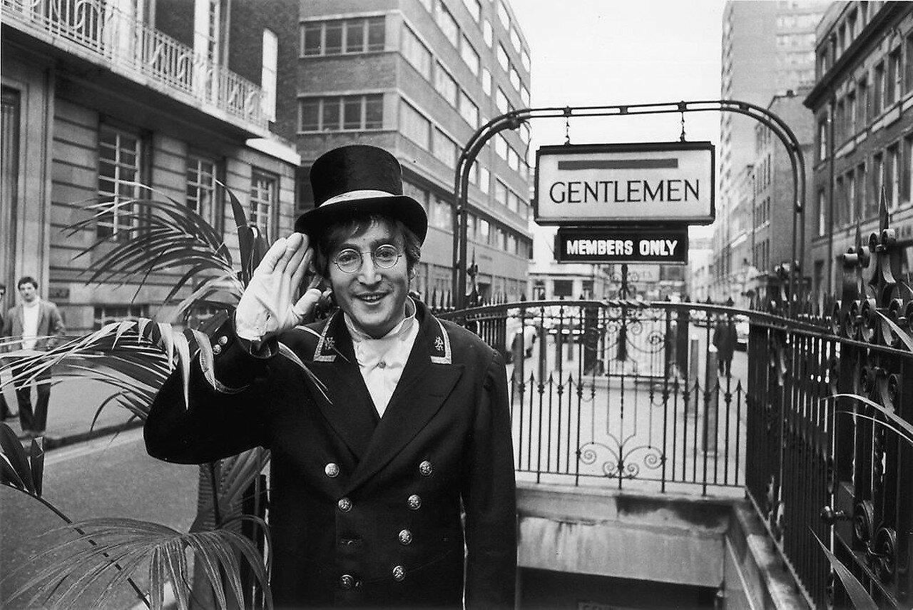 1966 Soho Lennon outside public toilets Broadwick Street during filming.jpg