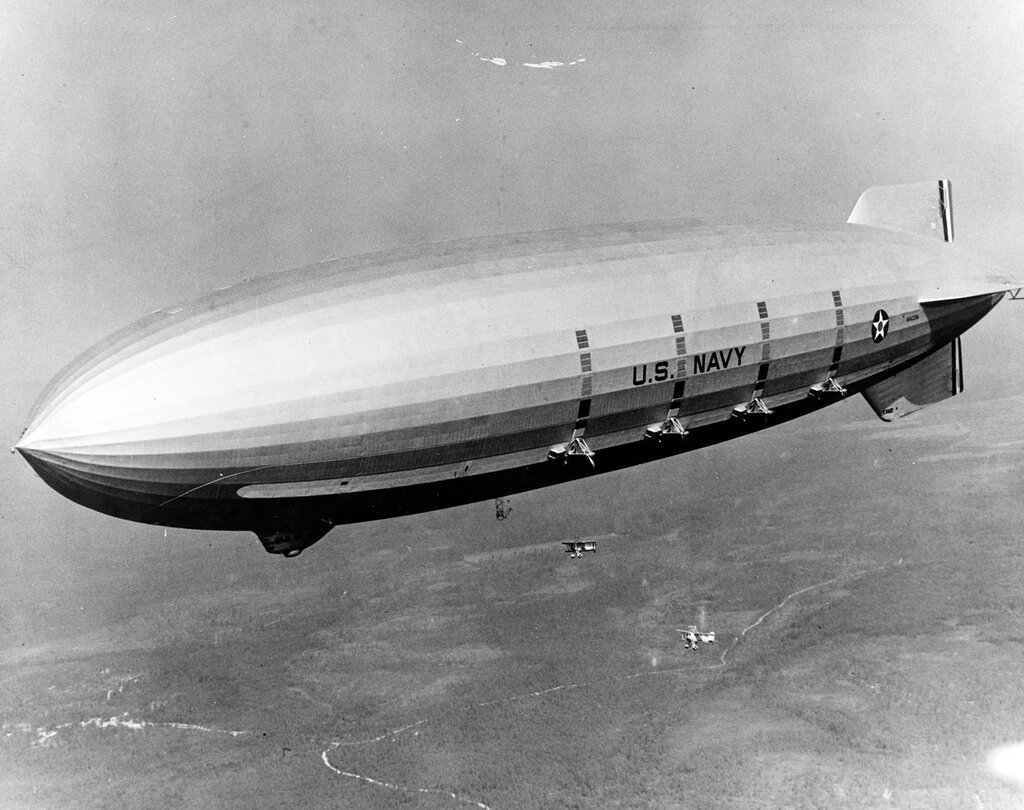 USS Macon (ZRS-5). Conducts initial operations with her Curtiss F9C-2 Sparrowhawk, over New Egypt, New Jersey, 7 July 1933