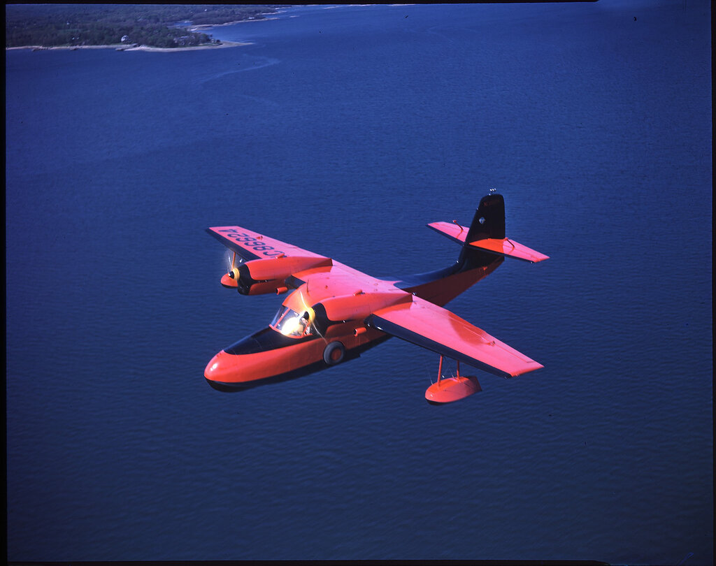 Grumman G-44 (Widgeon) (rn NC 86624) in flight over water near the Grumman facility on Long Island, New York