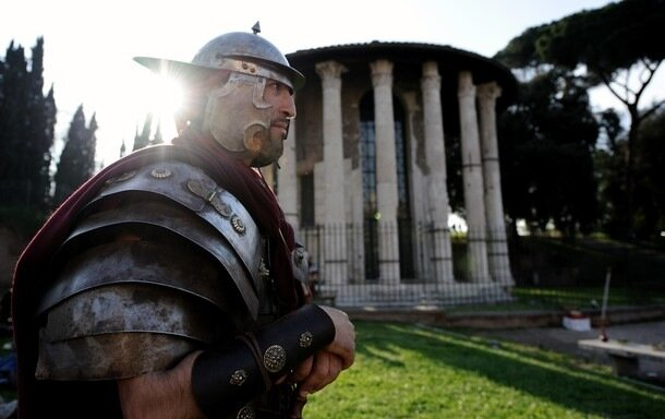 A man dressed up as an ancient Roman sol
